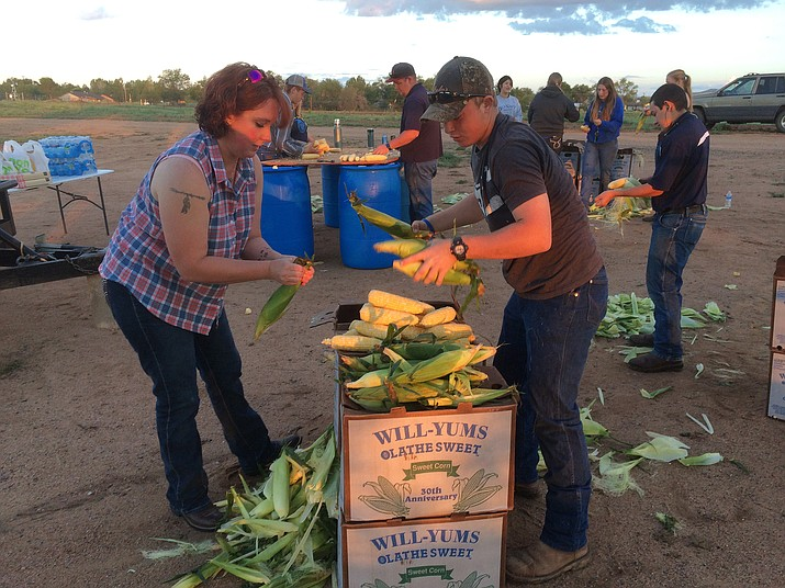 Karen Self and Levi Self shuck corn for the Saturday, Sept. 3, Corn Dinner. The annual event is a fundraiser for the FFA chapter at Chino Valley High School.