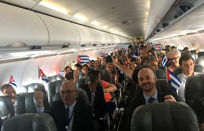Passengers of JetBlue flight 387 with the Cuban flag at the plane minutes beforae landing at the airport in Santa Clara, Cuba, Aug. 31, 2016.
