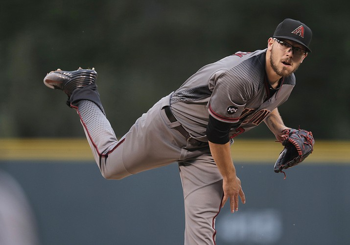 Arizona Diamondbacks starting pitcher Braden Shipley delivers a pitch to Colorado Rockies' DJ LeMahieu in the first inning of a baseball game Saturday, Sept. 3, 2016, in Denver.