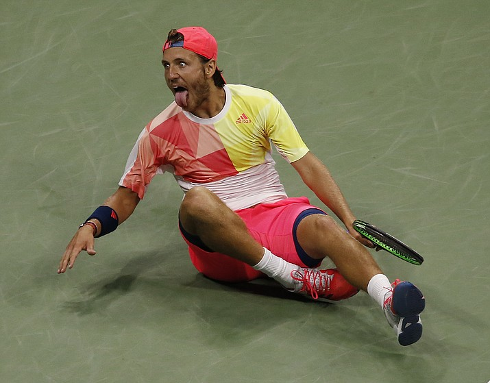Lucas Pouille, of France, reacts after beating Rafael Nadal, of Spain, during the fourth round of the U.S. Open tennis tournament, Sunday, Sept. 4, in New York.