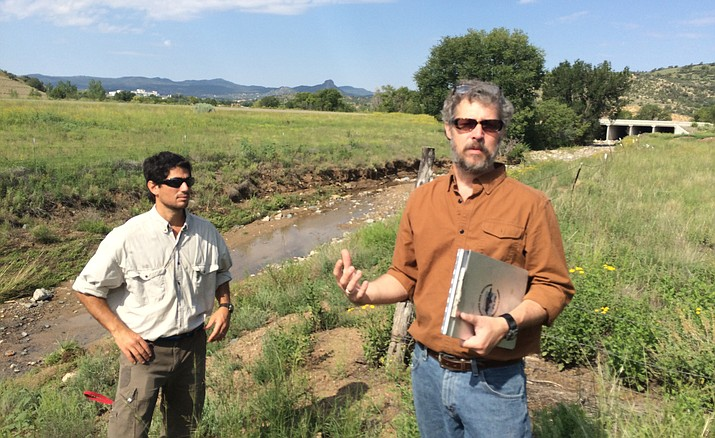 Guy Whol, left, and Michael Byrd of the Prescott Creeks organization talk about the importance of restoring natural qualities to the Slaughterhouse Gulch area along the Yavpe Connector.