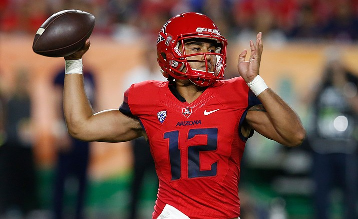 Arizona quarterback Anu Solomon throws during the first half of an NCAA college football game against BYU, Saturday, Sept. 3, in Phoenix.