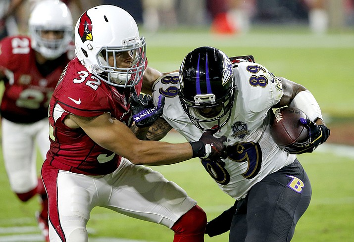 Baltimore Ravens wide receiver Steve Smith is stopped by Arizona Cardinals free safety Tyrann Mathieu during their Oct. 26, 2015, NFL football game in Glendale. This is a team that knows it's good as long as Carson Palmer stays healthy and Tyrann Mathieu returns strong from a torn ACL.