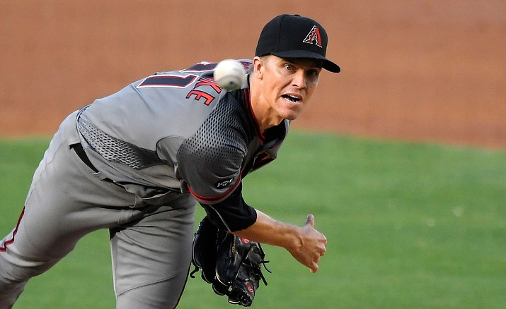 Arizona Diamondbacks starter Zack Greinke watches a pitch during a game against the Los Angeles Dodgers, Monday, Sept. 5, in Los Angeles.
