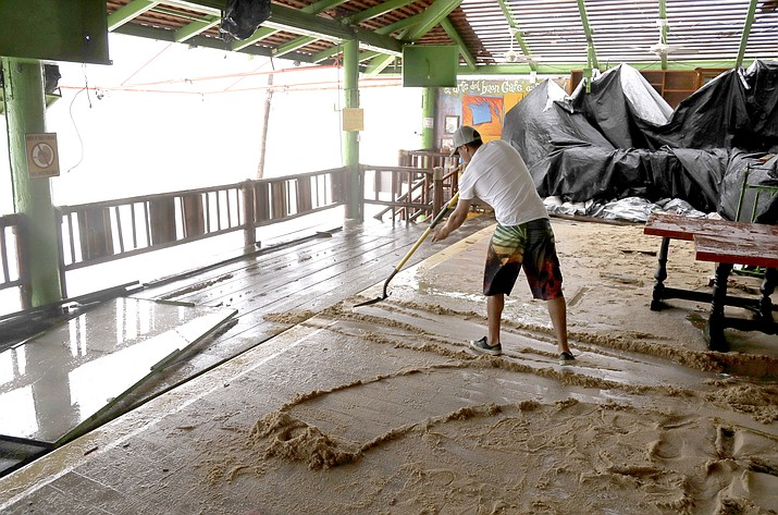 A man shovels mud inside a restaurant damaged by Hurricane Newton in Cabo San Lucas, Mexico, Tuesday, Sept. 6, 2016. The U.S. National Hurricane Center says Newton's winds Tuesday morning were around 90 mph (150 kph) and the storm is expected to still be a hurricane when it makes its second landfall on the northwest coast of mainland Mexico early Wednesday.