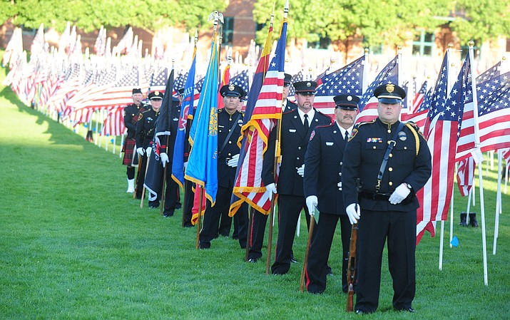 The multi agency honor guard waits in front of the Healing Fields during the 2015 Prescott Valley 9/11 Patriot Day Ceremony at the Prescott Valley Civic Center. Several hundred people attended the event. This year's event is on Sunday.
