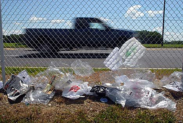 A chain-link fence stops windblown trash from going any further. The city of Kingman hopes residents take advantage of a clean up plan in advance of the  Best of the West festival later this month.