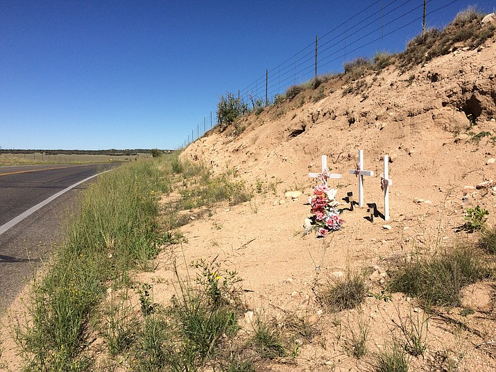 Roadside memorials, such as this one on Outer Loop Road marking the spot where three family members died in October 2013, may be allowed to remain, forever, under new rules issued by the Department of Transportation.