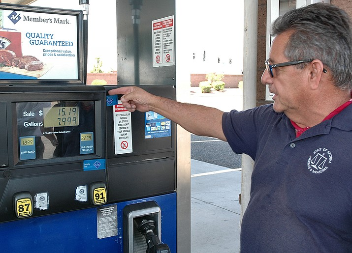Before using a credit card at a gas pump, check to see if the security tape has been torn. There may be a skimmer inside. (Capitol Media Services)