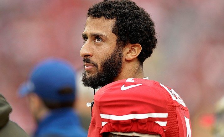 In this Nov. 8, 2015, file photo, San Francisco 49ers quarterback Colin Kaepernick stands on the field during an NFL football game against the Atlanta Falcons in Santa Clara, Calif. Kaepernick's protest of the national anthem over what he describes as oppression of minorities in the United States is apparently winning support from some veterans on Twitter under #VeteransForKaepernick. Kaepernick said he'll continue the protest during San Francisco's preseason game at San Diego on Thursday, Sept. 1.