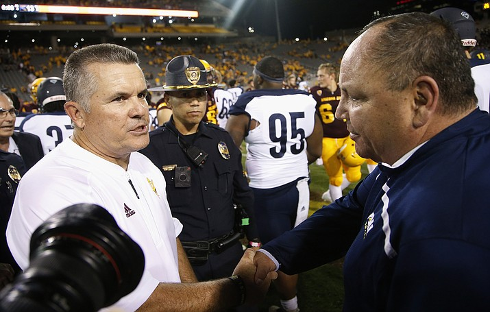 Arizona State head coach Todd Graham, left, shakes hands with Northern Arizona head coach Jerome Souers, right, after an NCAA college football game Saturday, Sept. 3, 2016, in Tempe, Ariz. Arizona State defeated Northern Arizona 44-13.