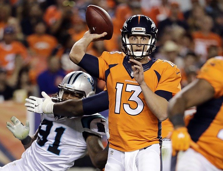 Denver Broncos quarterback Trevor Siemian throws under pressure from Carolina Panthers defensive end Ryan Delaire during the second half of an NFL football game, Thursday, Sept. 8, in Denver.