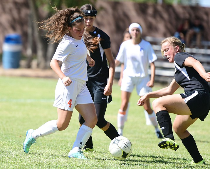 Chino Valley's Yenifer Gomez (4) gets the ball deep into the box as the Lady Cougars hosted Round Valley in a soccer matchup Thursday afternoon in Chino Valley. (Les Stukenberg/The Daily Courier)