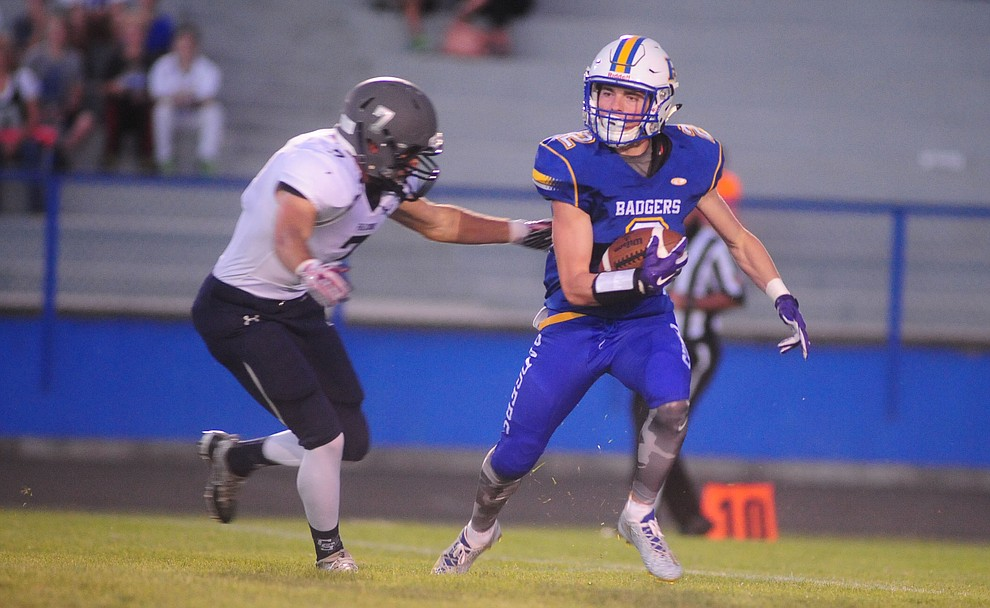 Prescott's John Chaffeur (2) takes the opening kickoff as the Badgers take on Cactus Shadows Friday night in Prescott. (Les Stukenberg/The Daily Courier)