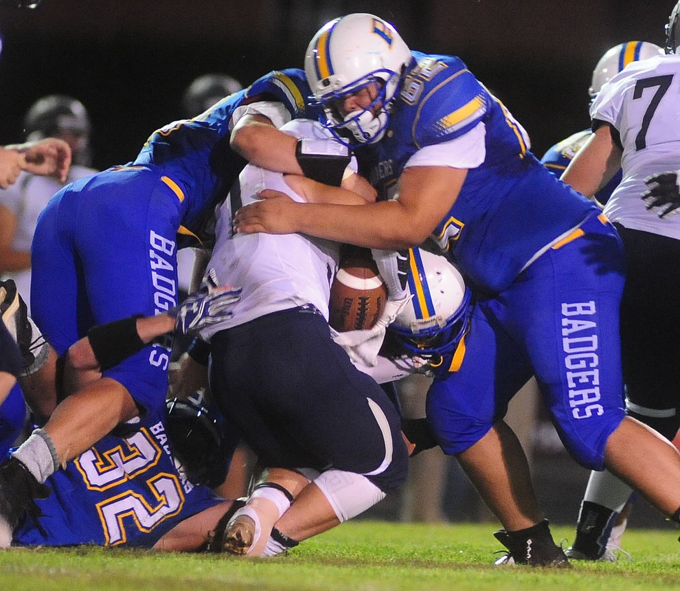Prescott's defense makes a stop as the Badgers take on Cactus Shadows Friday night in Prescott. (Les Stukenberg/The Daily Courier)