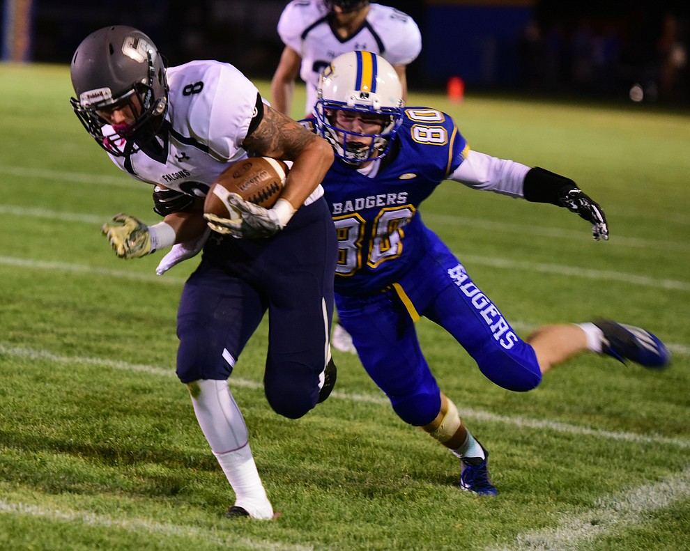 Prescott's Corey Huard (80) tackles Dylan Speirs (8) as the Badgers take on Cactus Shadows Friday night in Prescott. (Les Stukenberg/The Daily Courier)