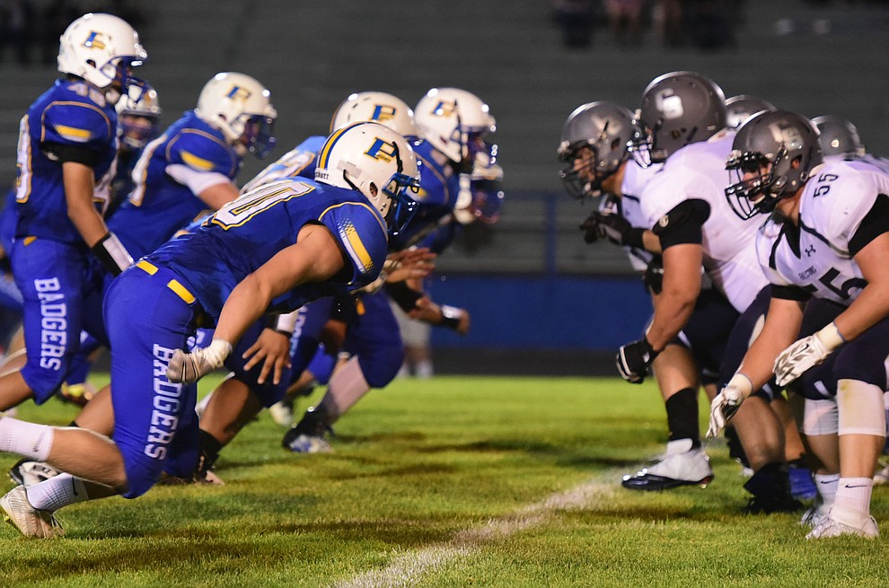 Prescott's defensive line gets off the ball as the Badgers take on Cactus Shadows Friday night in Prescott. (Les Stukenberg/The Daily Courier)