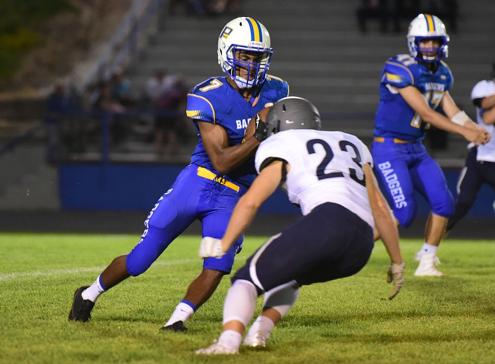Prescott's Dawson Winslow (7) tries to make an end around as the Badgers take on Cactus Shadows Friday night in Prescott. (Les Stukenberg/The Daily Courier)