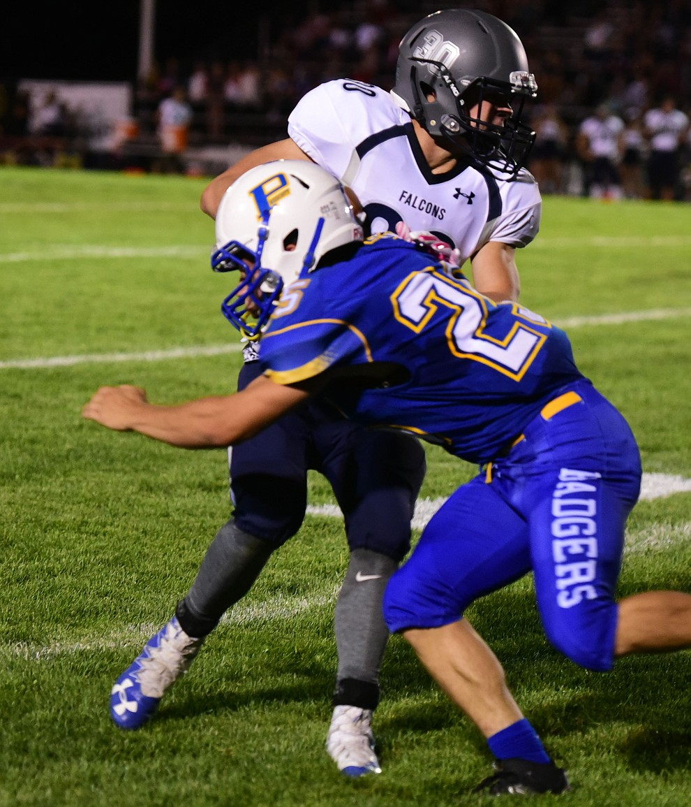 Prescott's Arthur McCracken (25) makes the tackle as the Badgers take on Cactus Shadows Friday night in Prescott. (Les Stukenberg/The Daily Courier)