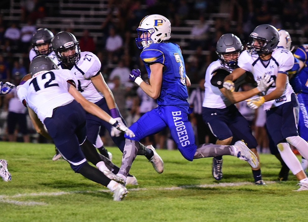 Prescott's John Chaffeur runs back a kickoff as the Badgers take on Cactus Shadows Friday night in Prescott. (Les Stukenberg/The Daily Courier)