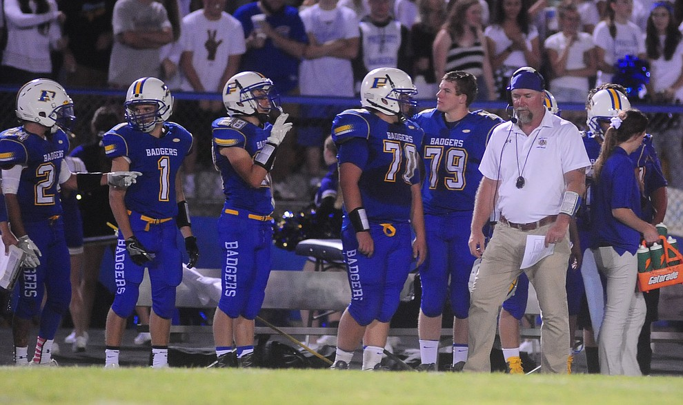 Prescott's Head Coach Michael Gilpin works the sidelines as the Badgers take on Cactus Shadows Friday night in Prescott. (Les Stukenberg/The Daily Courier)