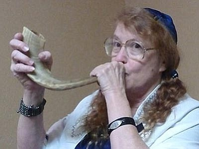 Rabbi Adele Plotkin demonstrates how to play the shofar, an ancient musical horn made of ram's horn.