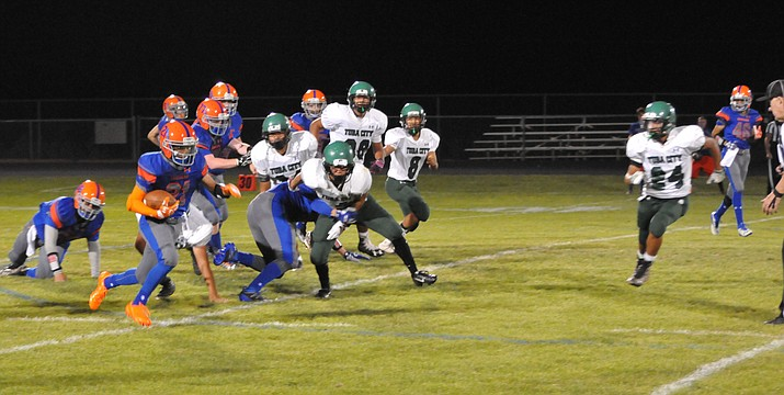 Chino Valley High senior tailback Andrew Granillo (No. 21) finds some running room in the first half against Tuba City Friday night, Sept. 9, on the Cougars' football field.