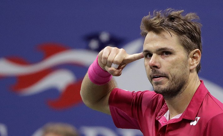 Stan Wawrinka, of Switzerland, reacts after a point to Novak Djokovic, of Serbia, during the men's singles final of the U.S. Open tennis tournament, Sunday, Sept. 11, in New York.
