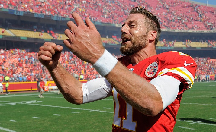 Kansas City Chiefs quarterback Alex Smith (11) celebrates after he scored the winning touchdown against the San Diego Chargers in overtime in an NFL football game in Kansas City, Mo., Sunday, Sept. 11. The Kansas City Chiefs won 33-27.