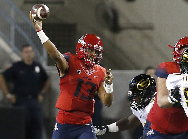 Arizona quarterback Brandon Dawkins (13) throws down field against Grambling State during the first half of an NCAA college football game, Saturday, Sept. 10, 2016, in Tucson, Ariz.