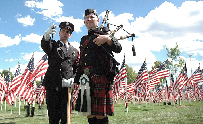 Fire Service Honor Guard member Jeremiah King, left, and Doug Copenhaver of Central Arizona Fire discuss the details of their part in the Prescott Valley ceremony commemorating the victims of the Sept. 11, 2001 terrorist attacks. The Sunday event took place on the grounds of the Prescott Valley Civic Center, with the Healing Field of Northern Arizona as a backdrop.