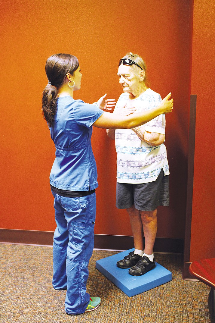 Marie Boone, a physical therapist and movement specialist at KRMC's Outpatient Rehabilitation Center, works Wednesday with patient Sylvia Hall, who was standing on a piece of foam. The exercise is strengthening Hall's balance.
