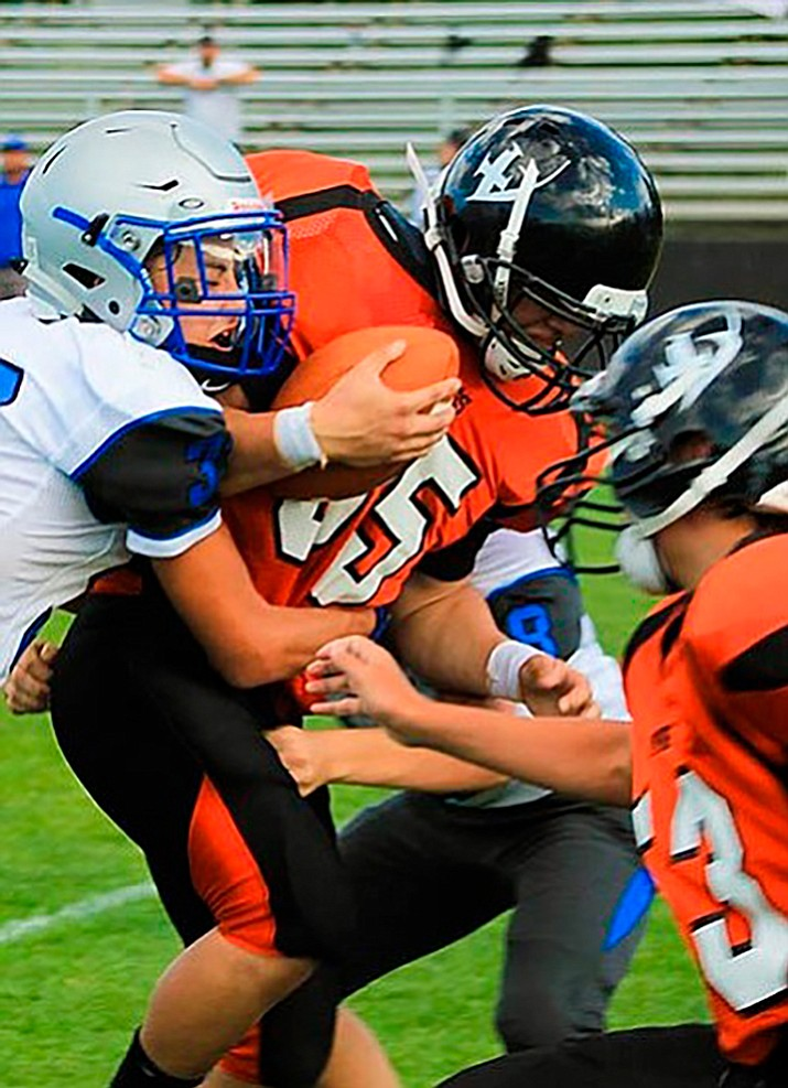 Dorian Ayala breaks through a tackle during the JV game with Bagdad Aug. 30. Wendy Howell/WGCN