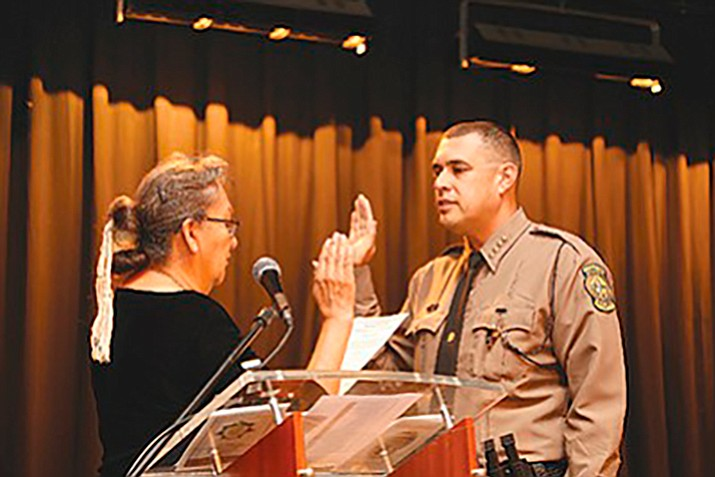 Navajo Nation Chief of Police Phillip Francisco is sworn in Aug. 22 by Associate Justice Eleanor Shirley.