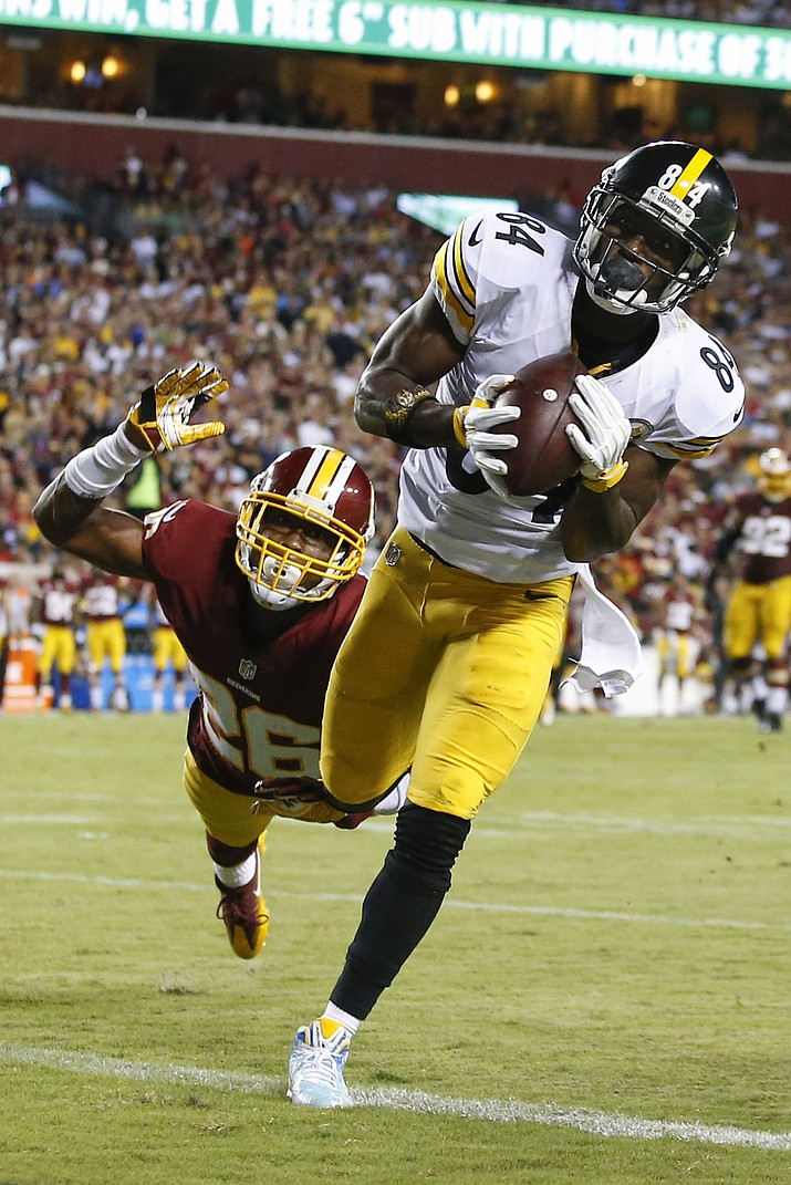 Pittsburgh Steelers wide receiver Antonio Brown scores a touchdown on a pass from quarterback Ben Roethlisberger, as Washington Redskins cornerback Bashaud Breeland dives toward him during the second half of an NFL football game in Landover, Md., Monday, Sept. 12.