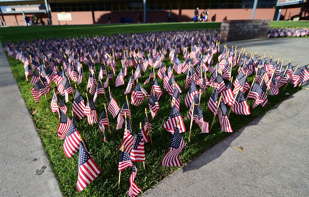 Flags planted to represent the victims of the September 11, 2001 terrorist attacks during a 9/11 Remembrance ceremony Monday morning at Prescott High School.  (Les Stukenberg/The Daily Courier)