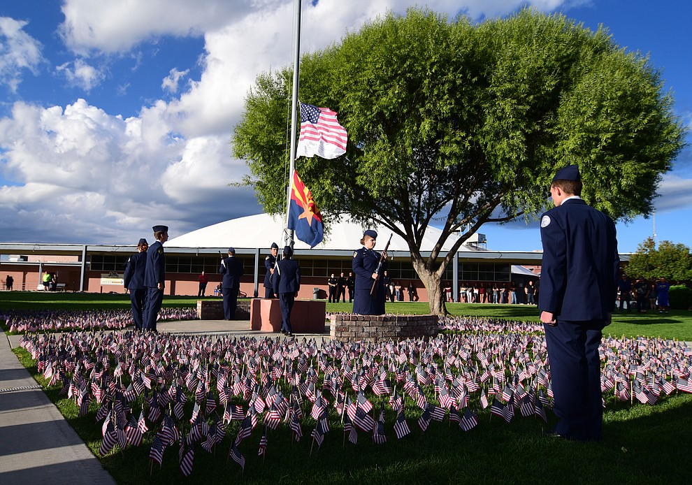 Members of the Prescott High School AFJROTC Honor Guard raise the flag during a 9/11 Remembrance ceremony Monday morning at Prescott High School.  (Les Stukenberg/The Daily Courier)