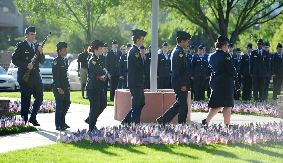 The Prescott High School AFJROTC Honor Guard prepares to raise the flag during a 9/11 Remembrance ceremony Monday morning at Prescott High School.  (Les Stukenberg/The Daily Courier)