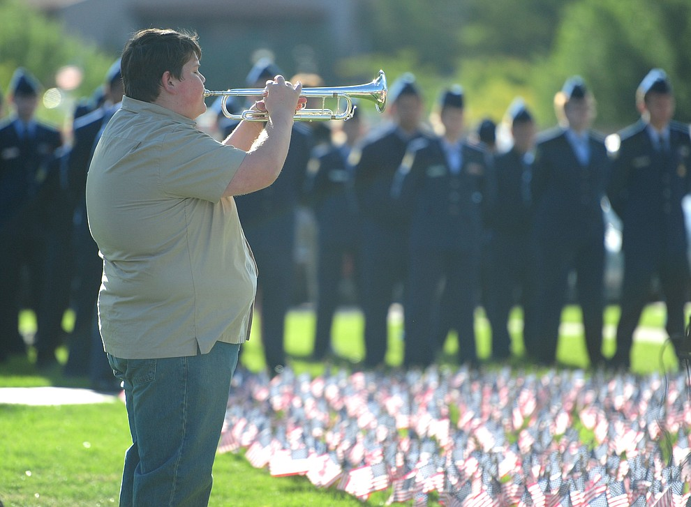Prescott High School Bryan Malone plays taps during a 9/11 Remembrance ceremony Monday morning at Prescott High School.  (Les Stukenberg/The Daily Courier)