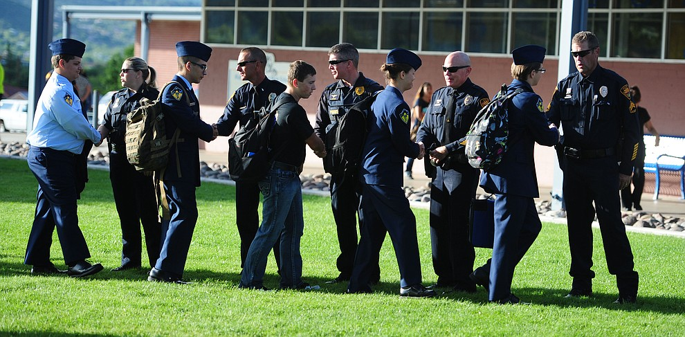 Prescott High School AFJROTC cadets thank Prescott Police officers for their service following a 9/11 Remembrance ceremony Monday morning at Prescott High School.  (Les Stukenberg/The Daily Courier)