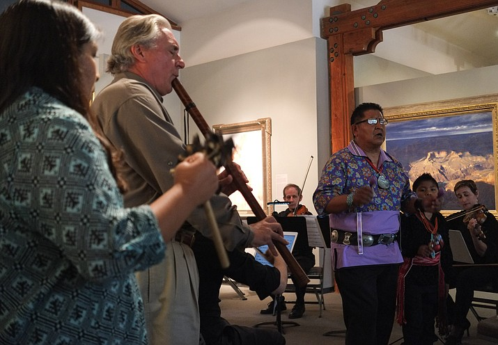 From left: Simana Tenakhongva, flautist Gary Stroutsos and Clark Tenakhongva perform a new genre of Hopi music called Puhutawi at the Museum of Northern Arizona Aug. 28.