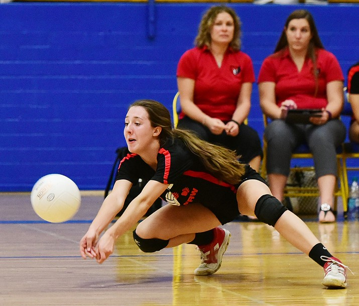 Bradshaw Mountain's Randee Clifford gets low to make a save as the Lady  Bears took on Flagstaff High School in a scrimmage at Prescott High School on Aug. 24. On Sept. 13, against Cactus Shadows, she had two service aces.