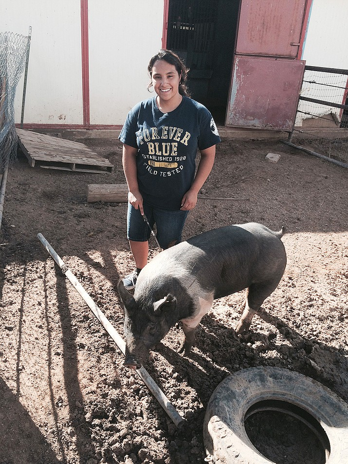 Adriana Aguillon and her pig, Gorda, at the 2015 Mohave County Fair.