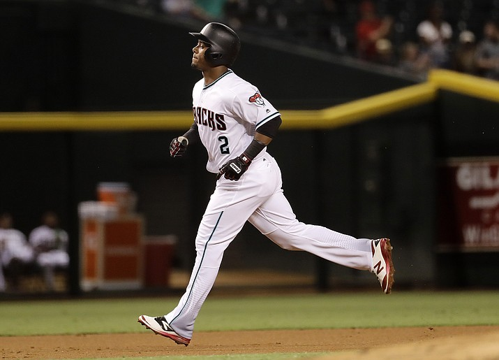 Arizona Diamondbacks Jean Segura rounds the bases after hitting a solo home run against the Colorado Rockies on Tuesday in Phoenix.