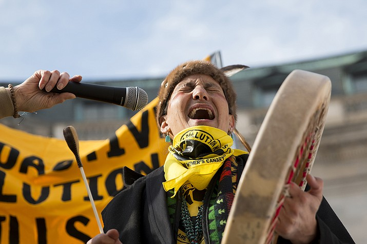 Klee Benally of the Navajo Nation, at a February protest outside the Environmental Protection Agency in Washington. There are an estimated 500 sites on the Navajo Nation contaminated with uranium, some of the thousands in the West. (Photo by Danika Worthington/Cronkite News).