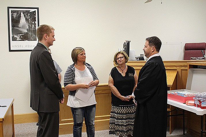 Navy veteran Sarah Jones, second from left, was the first person to graduate from the Veterans Treatment Court on Wednesday at Kingman Municipal Court. Also pictured, from left, are Thomas Godfrey, defense attorney, Dianne Stutts, mentor, and Judge Jeff Singer.
