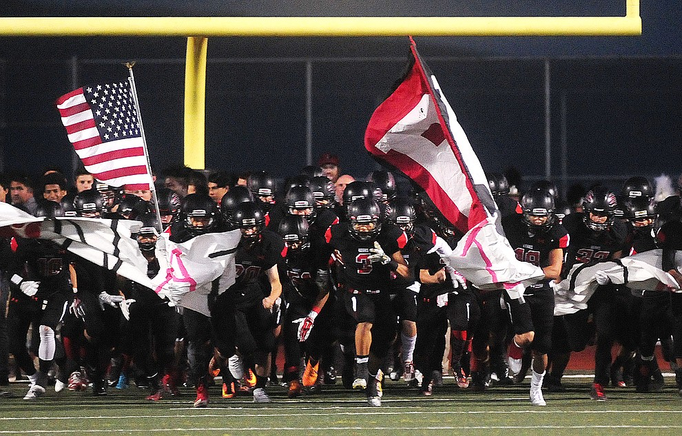 Bradshaw Mountain's Bears take the field against the Marco de Niza Padres Friday night in Prescott Valley. (Les Stukenberg/The Daily Courier)