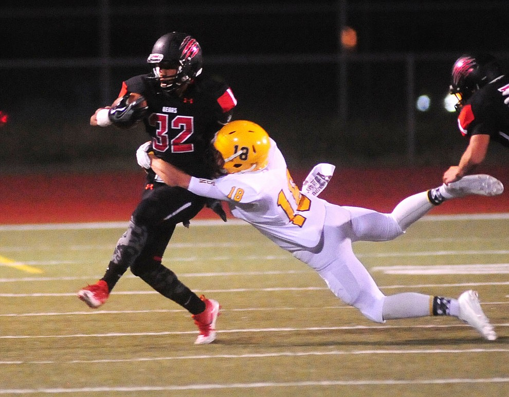 Bradshaw Mountain's Abraham Hernandez breaks a tackle as the Bears take on the Marco de Niza Padres Friday night in Prescott Valley. (Les Stukenberg/The Daily Courier)