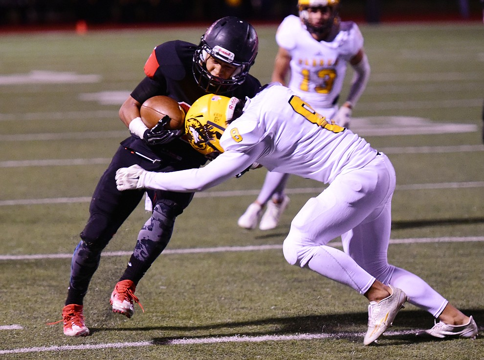 Bradshaw Mountain's runs hard for a first down as the Bears take on the Marco de Niza Padres Friday night in Prescott Valley. (Les Stukenberg/The Daily Courier)