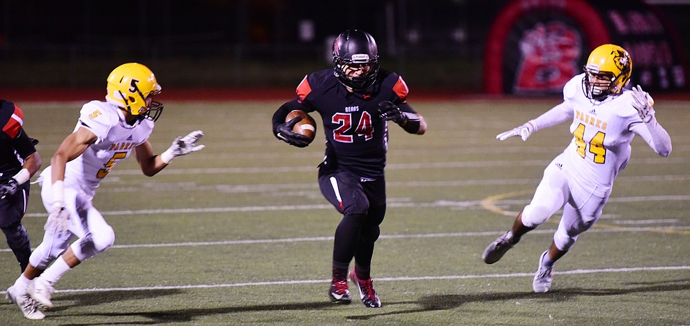 Bradshaw Mountain's Ryan Shaver breaks into the open field as the Bears take on the Marco de Niza Padres Friday night in Prescott Valley. (Les Stukenberg/The Daily Courier)